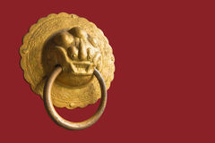 Close up of an isolated lion-shaped door knocker Royalty Free Stock Photos