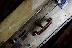 Close up of isolated old used suitcase with rivets, leather grip and combination locks royalty free stock photo