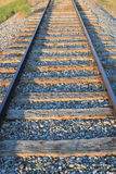 Close up of an isolated railway line with straight railway tracks leading into the distance Royalty Free Stock Photography