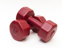 Close up isolated red fitness dumbbells. Royalty Free Stock Photography