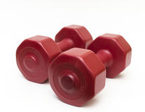 Close up isolated red fitness dumbbells. Royalty Free Stock Image