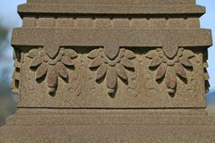 Ase of Stone Column with Repeating Decorative Petal Pattern royalty free stock images