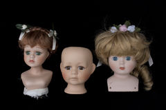 Close Up and Isolated Vintage Antique Old Doll Heads Stock Image