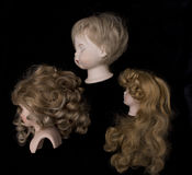 Close Up and Isolated Vintage Antique Old Doll Heads Stock Images