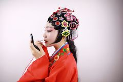 Close-up isolated white background Beijing opera Chinese female actress woman makeup traditional headwear costume drama portrait Royalty Free Stock Photography
