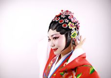Close-up isolated white background Beijing opera Chinese female actress woman makeup traditional headwear costume drama portrait Royalty Free Stock Photo