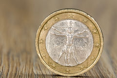 Close up of a Italian one euro coin. Close up of a one euro coin from the European Union member Italy showing the Vitruvian Man, a drawing by Leonardo da Vinci stock image
