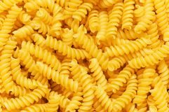 Close up of italian pasta. Spiral shaped Stock Photography