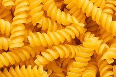 Close up of italian pasta. Spiral shaped Royalty Free Stock Images