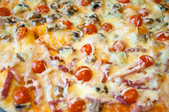 Close up Italian pizza as a background. Royalty Free Stock Photo