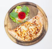 Close up italian pizza calzone Royalty Free Stock Image