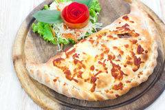 Close up italian pizza calzone Royalty Free Stock Photos