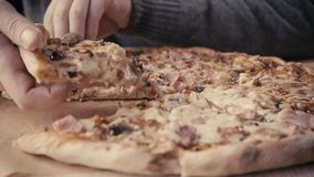 Close up Italian pizza about cheese it stick. Hand with delivery food margherita stock footage