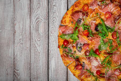 Close-up of an italian pizza. Freshly baked classic pizza on a table background. Ingredients for pizza. Copy space. royalty free stock photos