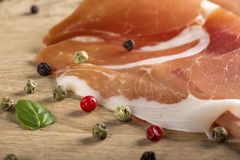 Close up of Italian prosciutto crudo with herbs Stock Photography