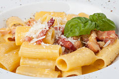 Close-up italian rigatoni plate with prosciutto, parmesan cheese Royalty Free Stock Image