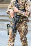 Close up of an Italian soldier in a city with an automatic rifle, emergency state concept Stock Image