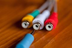 Close-up of a jack cord. On a wooden table stock photo