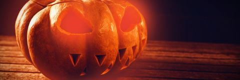 Close up of jack o lantern on table during Halloween. Close up of jack o lantern on wooden table during Halloween Stock Photography