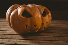 Close up of jack o lantern on table during Halloween Royalty Free Stock Photo