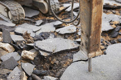 Close Up Of Jackhammer Breaking Up Road Surface Stock Photography