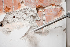 Close-up of jackhammer destroying walls Royalty Free Stock Image