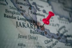 Close up of Jakarta pin pointed on the world map with a pink pushpin royalty free stock image