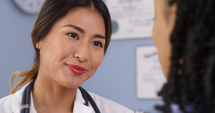 Close up of Japanese physician looking at patient Stock Photos
