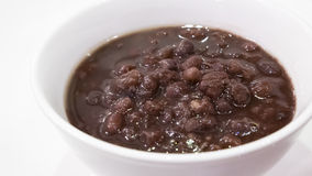 The close up of Japanese sweet red bean paste dessert soup. In small white bowl Royalty Free Stock Images