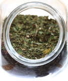 Close up jar with lovage spice isolated Stock Image