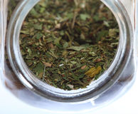 Close up jar with lovage spice isolated Stock Photo