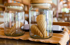 Close up of jars with waffle cones at restaurant Stock Photo