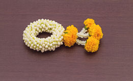 Close up jasmine garland of flowers on black wooden background Royalty Free Stock Photo