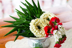 Close- up Jasmine garland and Rice offering  on the Tray with pe. Destal.Thailand Stock Image