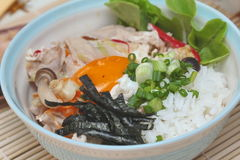 Close up jasmine rice topped soft boil eggs and fried pork. Selective focus. Stock Photo