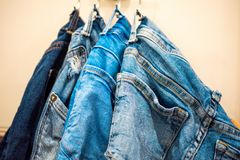 Close up of jeans on a rack royalty free stock photos