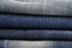 Close up of jeans pile Stock Photos