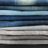 Close up of jeans pile Royalty Free Stock Images
