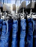 Close up of jeans on a rack stock image