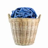 Jeans in a wicker basket on white background. Close-up Jeans in a wicker basket on white background royalty free stock image