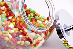 Close-up of jelly bean jar. Close-up of open jelly bean jar with colorful candy Royalty Free Stock Photography