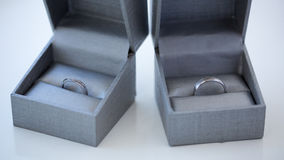 Close-up of a jewelry box with two elegant silver rings from which one with a diamond Stock Photos