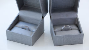 Close-up of a jewelry box with two elegant silver rings from which one with a diamond Royalty Free Stock Image