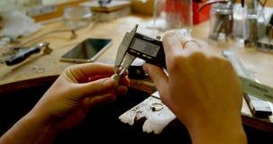 Jewelry designer using caliper in workshop 4k. Close-up of jewelry designer using caliper in workshop 4k stock footage