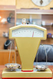 Close-up of jewelry scale. Close-up of an old-fashioned jewelry scale, while it's weighting some gold objects stock photography