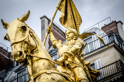 Close up of Joan of Arc on the Rue de Rivoli in Paris. The golden statue of Saint Joan of Arc on the Rue de Rivoli in Paris, France Royalty Free Stock Photo