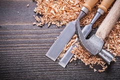 Close up of joiner's hammer and metal firmer Royalty Free Stock Images