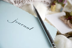Close up journal. Close up blue journal with pen put on scarf Royalty Free Stock Photo