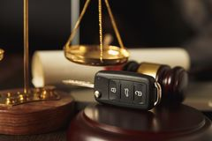 Close up of judge gavel and car keys over royalty free stock image