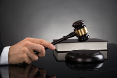 Close-up Of Judge Hitting Gavel Royalty Free Stock Image
